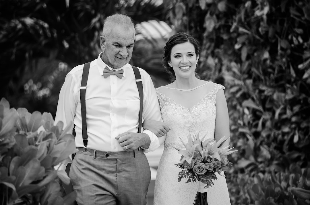 father of the bride walking down aisle