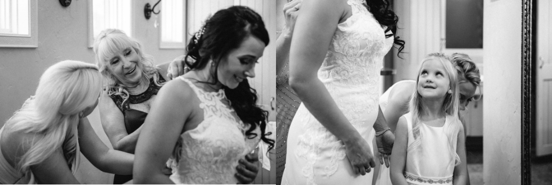 black and white bride getting dressed and flower girl looking at her