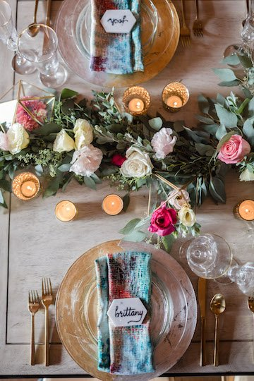 romantic floral and whimsical wedding table setting