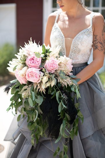unique wedding dress with bouquet