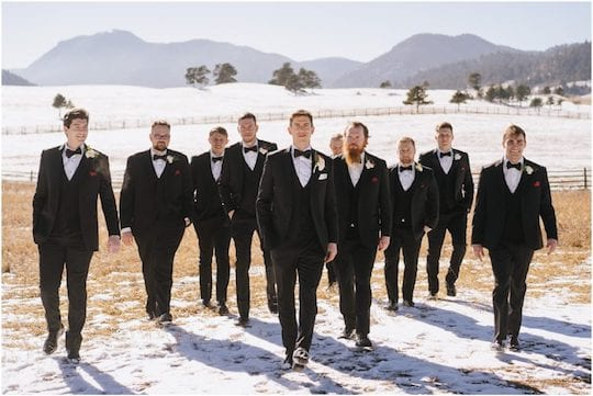 groomsmen standing in snowy field
