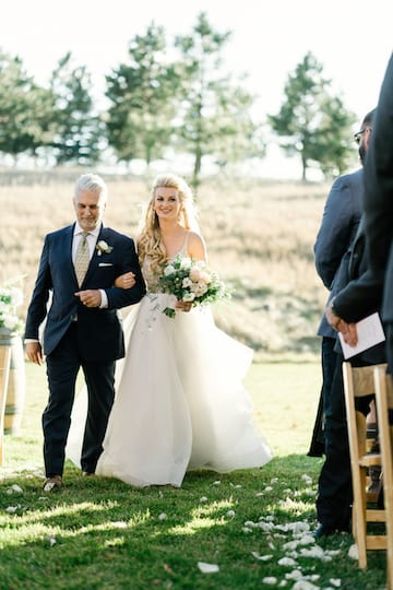 bride walking down the aisle at spruce mountain ranch